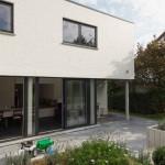 Extension d'une maison en façade arrière et latérale à Kraainem.